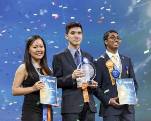 Top winner Austin Wang, 18, of Vancouver, Canada, (center) with second-place winners Kathy Liu, 17 of Salt Lake City, Utah, (left) and Syamantak Payra, 15, of Friendswood, Texas, celebrate their awards at the Intel International Science and Engineering Fair, the world's largest high school science research competition. Approximately 1,700 high schoolers from over 75 countries, region and territories competed for more than $4 million in awards this week. Winners were announced May 13, 2016, in Phoenix. (Credit: Shawn Morgan/Intel Corporation)