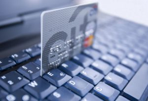 Mandatory Credit: Photo by Image Broker/REX (1869452a) Laptop and credit card VARIOUS